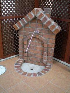 職人手作りの煙突のある立水栓
